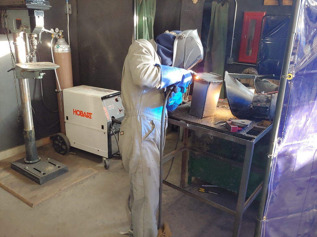 Students in Metal Fabrication learning to MIG weld!
